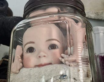 Antique Doll Parts in a Jar.