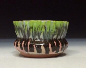 Pink green and black drippy glaze bowl