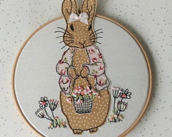 Daisy Rabbit freehand machine embroidery framed on a hoop with a ribbon hanging bow. 3D ears and flowers. New baby gift nursery itsagirl
