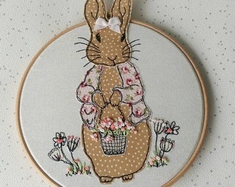 Daisy Rabbit freehand machine embroidery framed on a hoop with a ribbon hanging bow. 3D ears and flowers. MADE TO ORDER