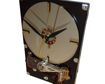Hard Drive Clock with Its Contoller Circuit Board as the Stand and Mirrored Disk Platter as the Dial.
