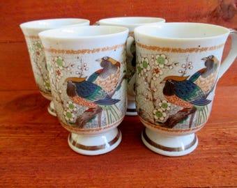 Pedestal coffee mugs set of four Japanese birds 1970s