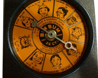 Vintage Toy. Metal Spinner Game Circa 1940s. Original Box. Bim Bum Game. Orange & Black. Great Condition. Made by Chicago Metallic Mfg Co.