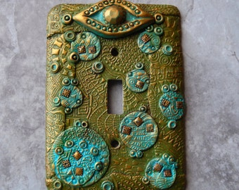 Cosmic Eye, light switch cover, one of a kind, polymer clay, olive greens, turquoise and gold