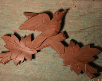 40's Wooden Bird, Cuckoo Clock Wood , Good condition, Folk Art Black Forest, German, Hand carved, Glass Eye, sitting in branches with Leaves