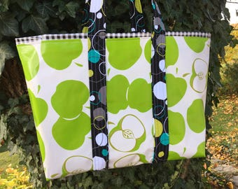 An apple a day reversible oilcloth tote bag in Granny Smith green