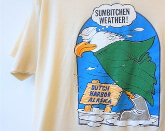 70s 80s Sumbitchin Weather Alaska Tshirt Bird Eagle Tshirt Funny Humor Screen Printed Graphic Light Yellow Cotton Paper Thin Tee (S) E978