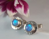 Handmade silver earrings with round blue lab opals and a hammered finish