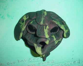 Original stoneware kissing creature