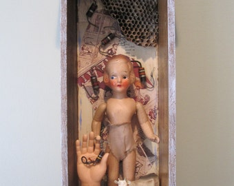 Mixed media assemblage, shadow box, found object art, 3D art, creepy dolly