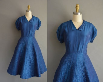 50s midnight shimmery blue vintage dress with a quilted skirt. vintage 1950s dress