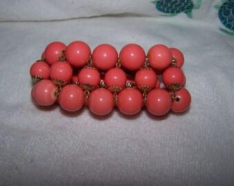 Triple Row Orange Coral Bead Bracelet