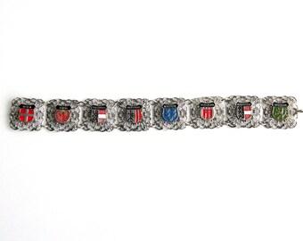Vintage Austrian Tourist Souvenir Shield Bracelet - Silver Filigree Panels - Red Black Blue Green Enamel - 8 Charm Shields
