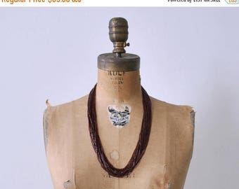25% OFF 1920's maroon beaded necklace. art deco. glass bead. red brown. 20's strand necklace.