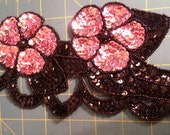 Pink and black sequined and beaded applique
