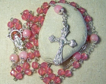 Catholic rosary with opal pink faceted glass beads in silver
