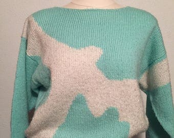 Adell Barre fuzzy turquoise and white sweater with silver sparkle bird