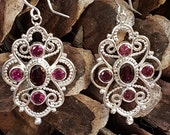 Handcrafted artisan sterling silver piecework Bali style earrings with rhodolite garnet gemstones.