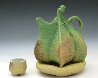 Porcelain pod teapot, carved, green with tan pillow & tea bowl, earthtone, textured, mottled