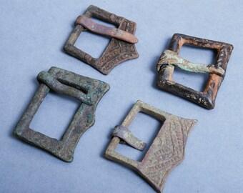Set of 4 antique connectors parts of brass  belt buckles, dark patina