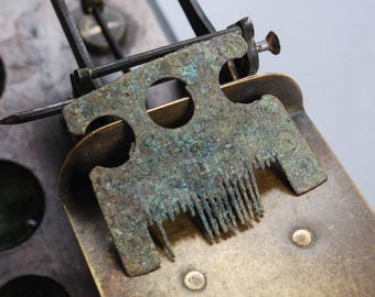 Antique brass part of old comb, part, head of horse finding dark patina