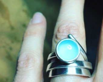 Coiled silver ring with aquamarine chalcedony.