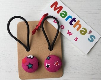 Pair of pink button hair ties, bright pink with stars