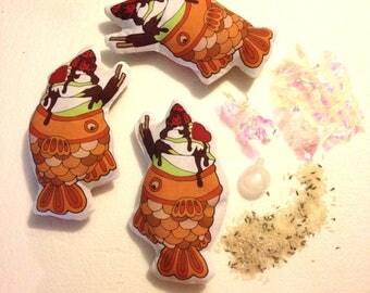 Fidgety Fish Taiyaki Ice cream fish pastel weighted fidget toy squeaker lavender rice mylar crackle original artwork