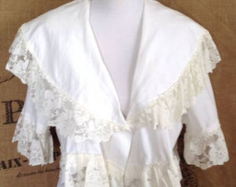 Lace trimmed white blouse