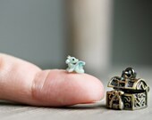 Tiny miniature green dragon in a metal locket charm