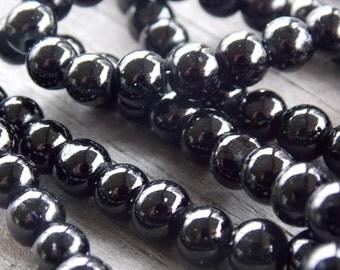 140 Black Glass Pearls 6mm 30 inch strand