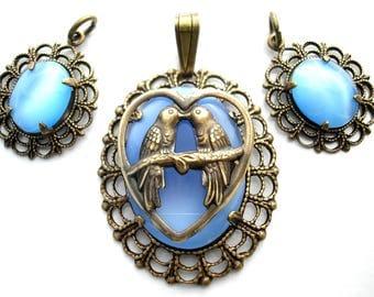 Three Piece Set of Blue Glass Moonstone Pendants with Brass Lovebirds