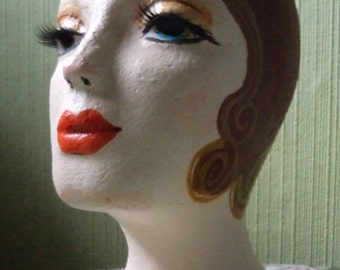 Hand painted mannequin a red headed flapper girl.