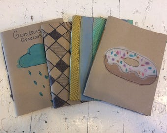 Set of 4 hand bound and illustrated blank note pad/books, scratch pads