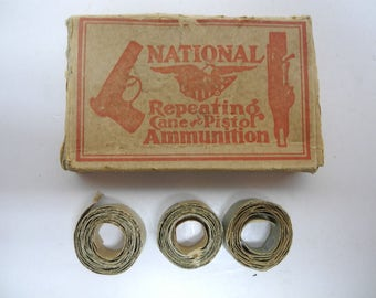 1920's National Repeating Cane & Pistol Ammo Box with 3 Cap Gun Rolls