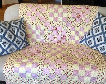 Sweet pea pink and yellow cotton quilt. Hand made.  Dimensions  50x64