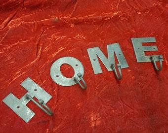 Custom wrought iron letter hooks