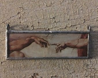 Michelangelo's Creation of Adam Hands Pendant / Sistine Chapel (double sided) made from vintage / antique books