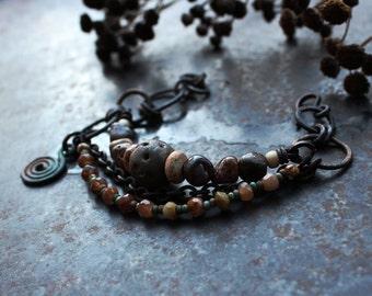 Brown bracelet with spiral charm, rustic ceramic bracelet, celtic symbol bracelet, norse bracelet, charm bracelet