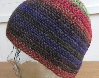 Crochet beanie hat in reds, green and purples