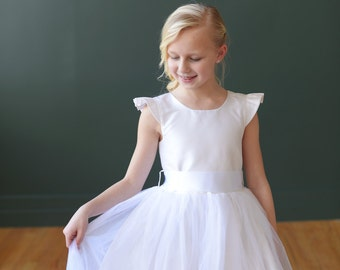 Flower Girl Dress : Pure silk flower girl dress in ivory or white with diamante, capped sleeves and full tulle skirt.