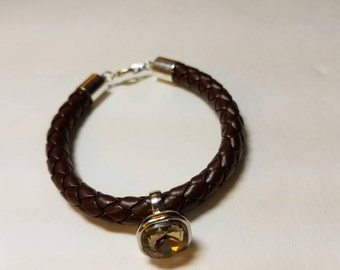 Brown braided faux leather bracelet with charm