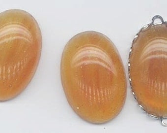 Two rare vintage Japanese Cherry Brand glass cabochons - swirled amber - 25 x 18 mm