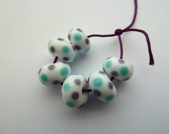 handmade lampwork glass beads, blue and purple spotty beads