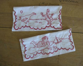 French fabric pouches with red embroidered ducks and boy and boat