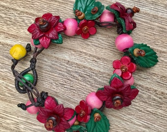 Melissa's poinsettia leather flower all around braided bracelet