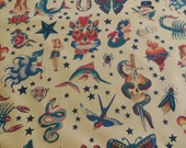 "Alexander Henry ""Tattoo"" Fabric - Tea Colored back ground color 1 Yard"