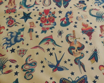 """Alexander Henry """"Tattoo"""" Fabric - Tea Colored back ground color 1 Yard"""