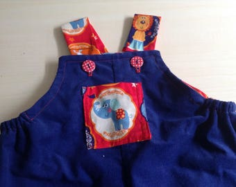 Baby boy/girl  - size 1  (12 months  ) long leg overalls . Blue corduroy   with circus print