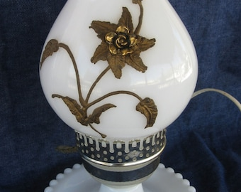 milk glass electric table lamp, chimney has brass floral decor, works, 1960's